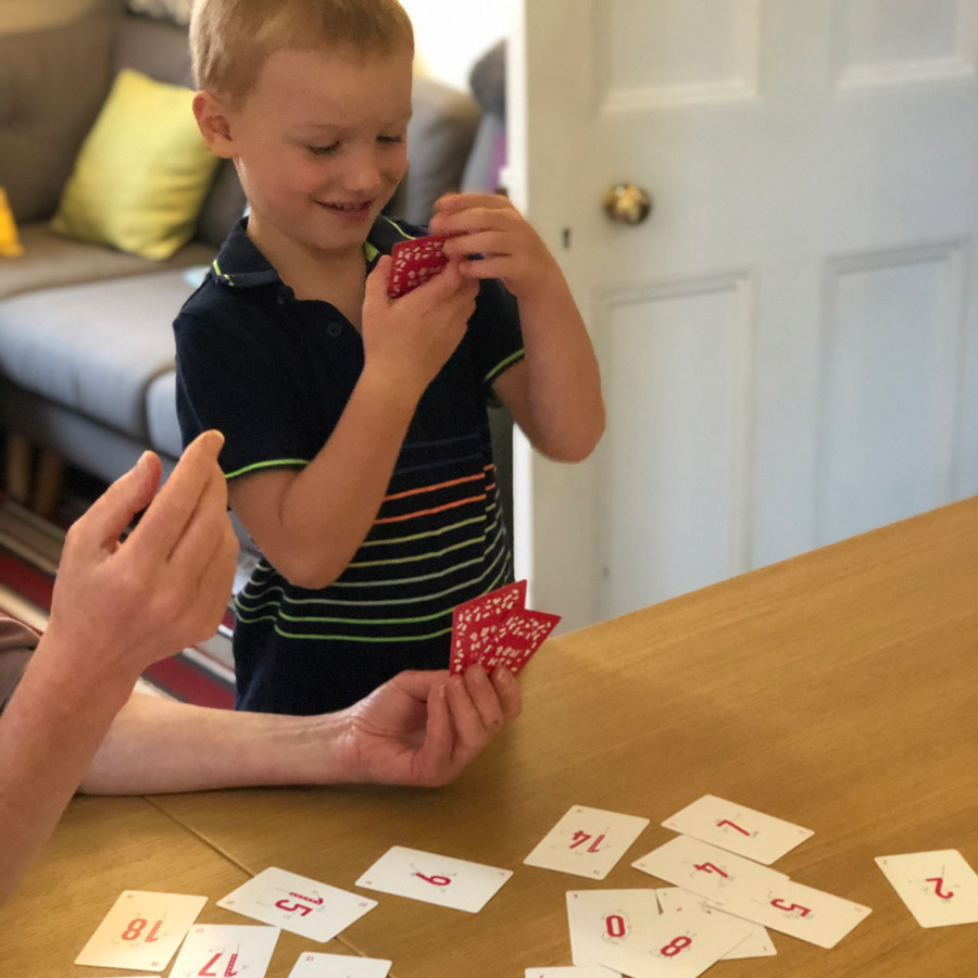 Young boy with cards at home